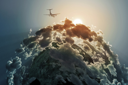 above clouds: airplane flies above clouds