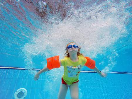 float: child swim in the pool Stock Photo