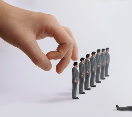 out of control: ruling hand optimizes staff Stock Photo