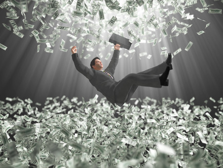 businessman falls through a money clouds