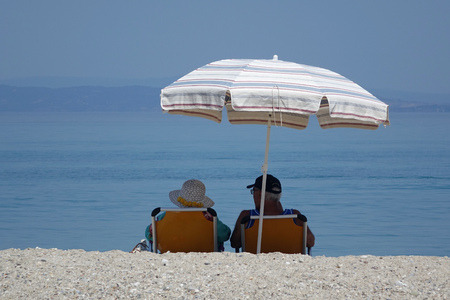 elderly couple on a summer beach