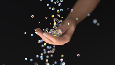 sparkling crystals fall into the hand