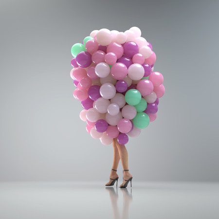 Attractive woman in a bunch of balloons