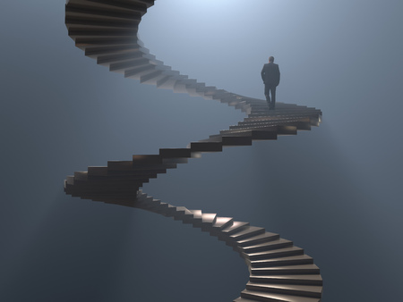 man climbs the spiral staircase