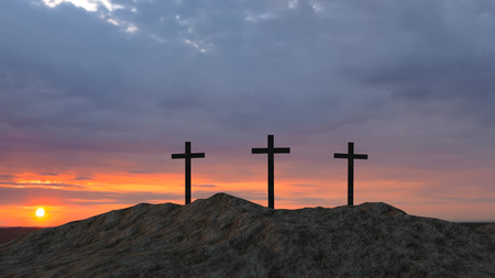 three crosses on top of a hill at sunset