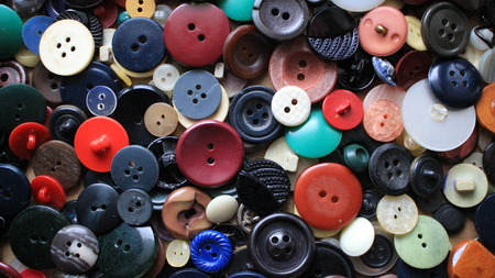 Old buttons of different colors and shades