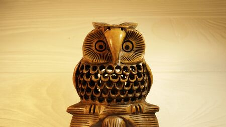 Statuette of an owl a symbol of wisdom and tranquility, made of wood.