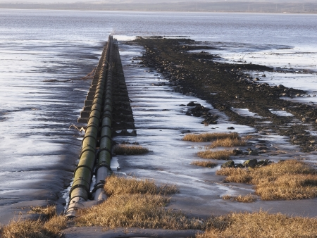 severn: Severn beach on the estuary, pipe going into sea, Gloucestershire, January 2011