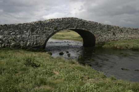 Aberffraw bridge,  hump backed stone built,  Wales photo