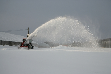 snow clearing: Snow clearing machine working in Japan Stock Photo