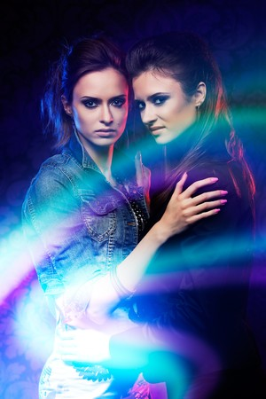 Female twins, studio shooting with light painting. Stock Photo - 8217666