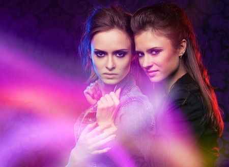 Female twins, studio shooting with light painting. photo