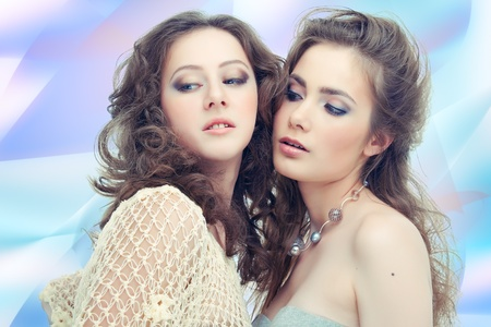 Two passionate women on abstract background Stock Photo