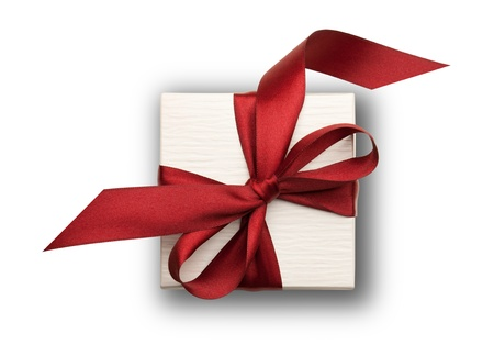 A white box tied with a red ribbon bow isolated on white, view from above. The best gift for Christmas, Birthday, Valentiness day or Wedding.