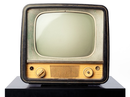 An old television standing on a black table on white background. Put your image or design on the screen Stockfoto