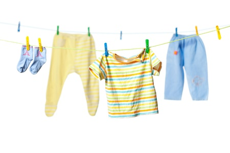 Baby clothes drying on a rope isolated on white background Stock Photo - 11784297