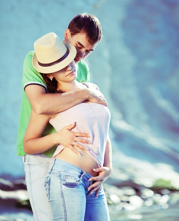 Young couple hugging passionately on the beach Stock Photo - 12859824