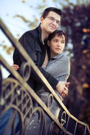Young couple hugging in the autumn park and looking to a bright future Stock Photo - 12859779