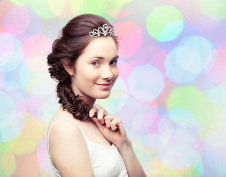 Beautiful young woman with a braid wearing a diamond diadem