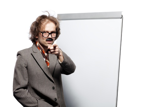 Professor  scientist  lecturer wearing horn rimmed glasses and fake mustache standing in front of a whiteboard and pointing into camera