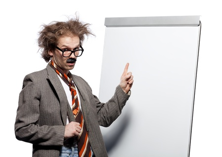 Crazy professor / scientist / lecturer with mad hairstyle wearing horn rimmed glasses and fake mustache standing in front of a whiteboard and pointing it