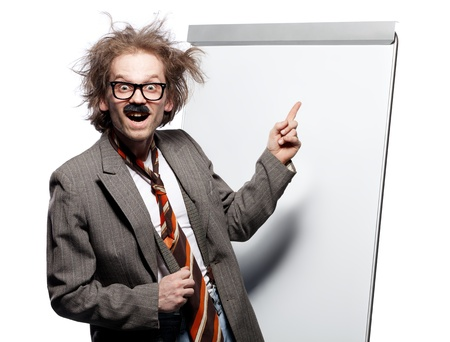 Crazy professor / scientist / lecturer with mad hairstyle wearing horn rimmed glasses and fake mustache standing in front of a whiteboard and pointing it with happy goofy face
