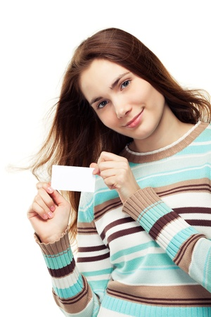Beautiful young woman in a striped sweater holding a blank business card, isolated on white