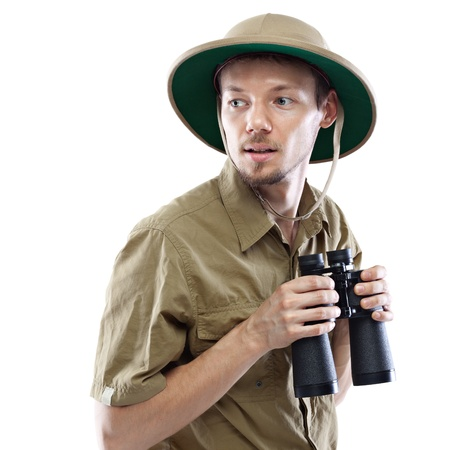 pith: Young man wearing safari shirt and pith helmet holding binoculars, isolated on white background