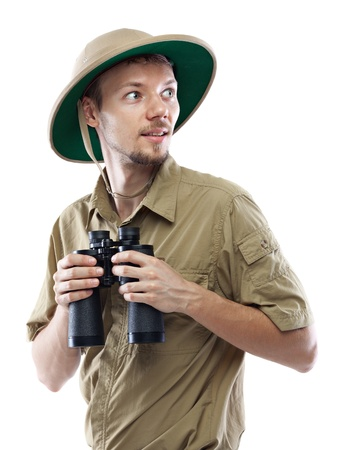 Young man wearing safari shirt and pith helmet holding binoculars, isolated on white background photo