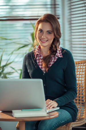 surfing the net: Young woman surfing the net Stock Photo