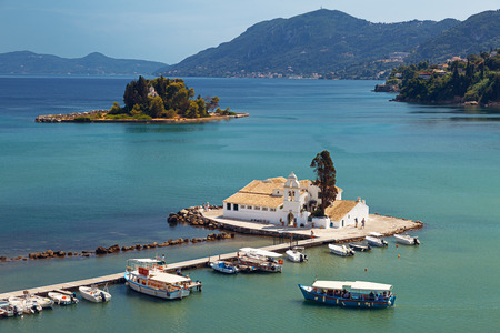 is well known: Postcard view of Vlacherna Monastery and Mouse island on Corfu, Greece. Probably the most iconic and well known corfiot landmarks.