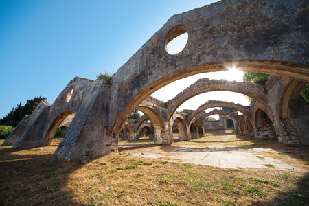 arsenal: The Venetian arsenal at Gouvia, Corfu. The arches of the docks and the gateway is seen through the arches Stock Photo