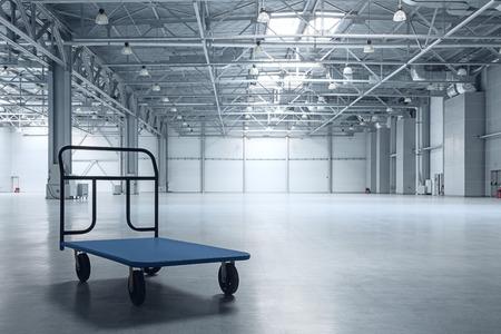 Interior of empty warehouse with a cart Foto de archivo