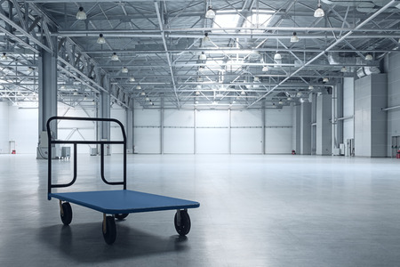 Interior of empty warehouse with a cart Stock Photo