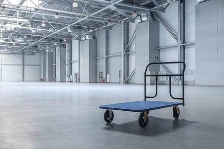 Interior of empty warehouse with a cart Standard-Bild