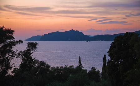 Dramatic coastal sunset on Corfu island, Greece
