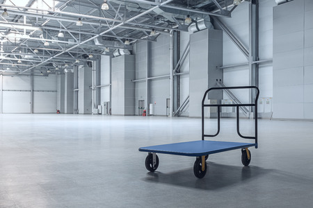 delivery room: Interior of empty warehouse with a cart Stock Photo