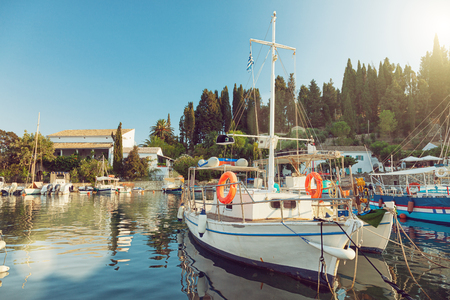 Colorful fishing boats docked in the harbor of Kalami, Corfu island, Greece Stock Photo