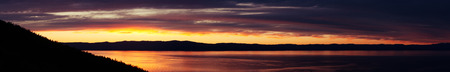 cirrostratus: Panorama of coast at the cape Khoboy, Olkhon island, Baikal. Dramatic red, purple, and yellow sky with clouds, coast sunset with silhouette mountains