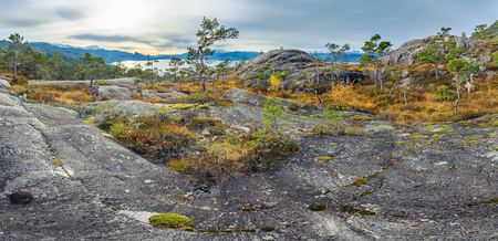 Panoramic view of norwegian rocks and distant fjord Stock Photo