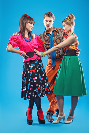 Young people wearing colorful old-fashion clothes in pinup style. Also they can represent members of a youth counterculture Stilyagi existed from the late 1940s until the early 1960s in the Soviet Union Stock Photo