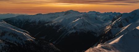 Winter panoramic landscape with sunset over Tatra Mountains, Zakopane, Poland Stock Photo