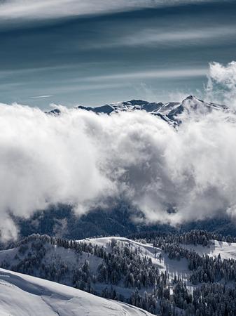 View from the Rosa Peak of  Caucasus mountains. Sochi, Krasnaya Polyana (Rosa Khutor alpine ski resort), Western Caucasus, Russia.