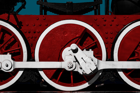 Contrast red and white wheels of old locomotive, close up