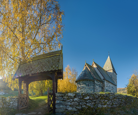 Autumn landscape with a norwegian countryside church at sunset