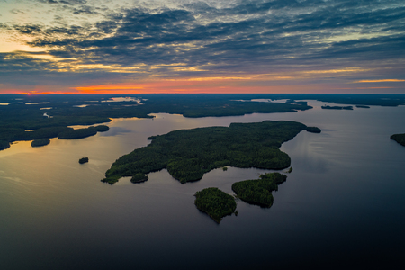 Aerial view of Suoyarvi lake at sunset surrounded by forests of Karelia, Russia