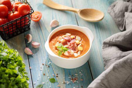 Salmorejo, spanish cold tomato soup, served in bowl with hamon