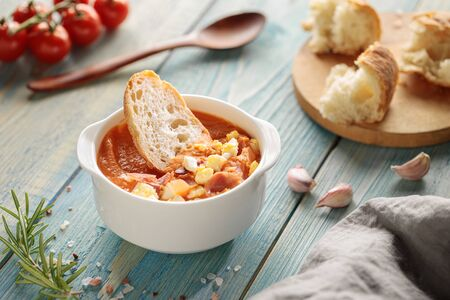 Salmorejo, spanish cold tomato soup, served in bowl with ham and bread Фото со стока