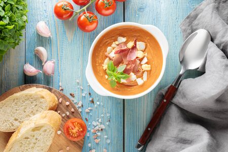 Flat lay with spanish cold tomato soup salmorejo, bread and other ingredients