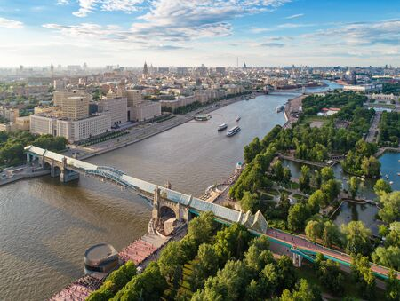 Aerial view of the main building of the Ministry of Defence of the Russian Federation, Pushkinsky (Andreevsky) over Moskva-river and Gorky park at summer, Moscow, Russia